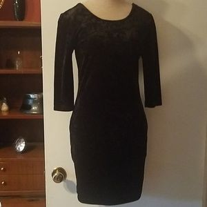 Super cute black velvet dress.
